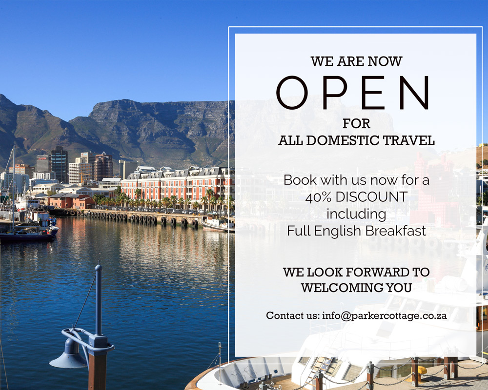 Parker Cottage reopening 2020 special offer with a beautiful picture of boats in the Cape Town harbour with Table Mountain in the background